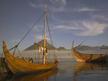 """Lofotr"" a full size reconstruction of the ""Gokstad"" Viking ship and a smaller 8 oared boat."