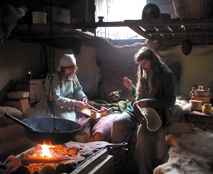Working inside a Viking house. The Vikings were great craftsmen and examples of Viking crafts still survive from many sites.