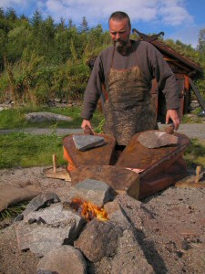 Ken Ravn Hedegaard working the bellos to melt bronze before a casting can be made