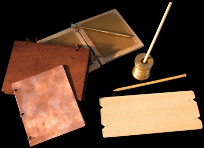 Roman writing materials. wax tablets, wooden leaves writen on with ink and reed pens. Bronze  Diploma.
